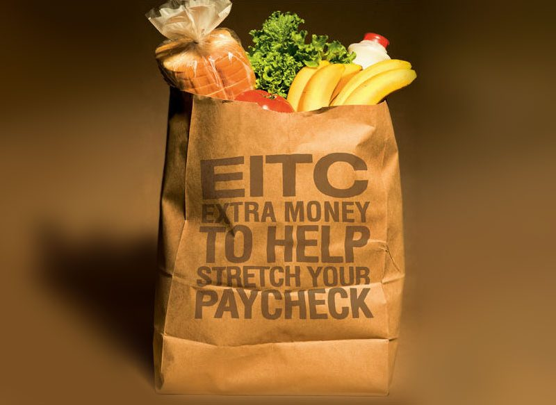 """graphic image of grocery bag with, """"Earned Income Tax Credit (EITC) extra money to help stretch your paycheck"""" written on it."""
