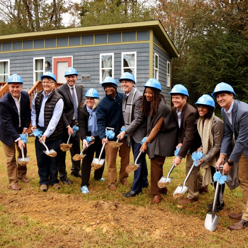 image of School of Social Work faculty and Chatham County officials breaking ground for Tiny Homes Village ceremony.
