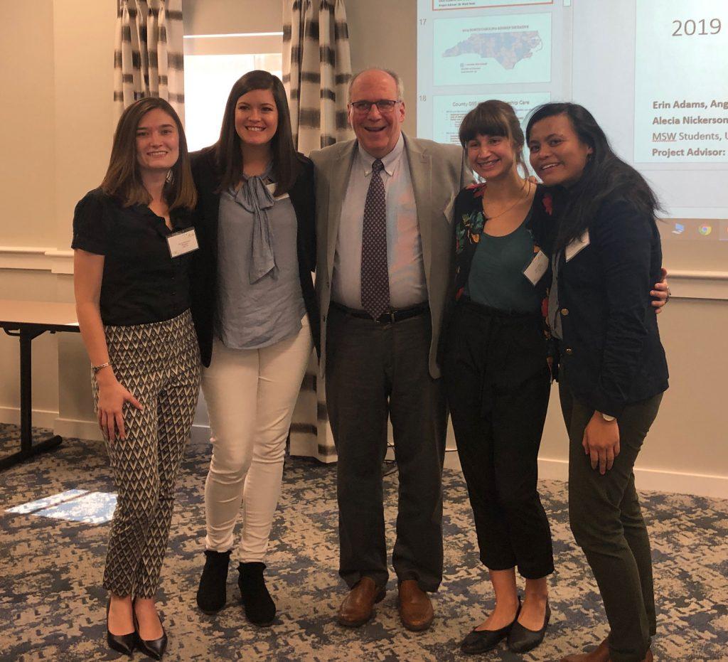 image of professor Mark Testa with MSW students Alecia Mitiguy, Katie Pollard, Erin Adams and Angela Krider
