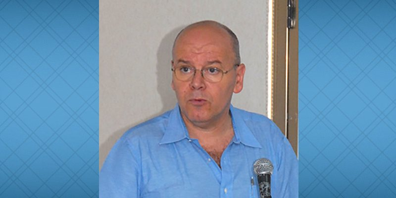 image of Couty Sabeh speaks at microphone