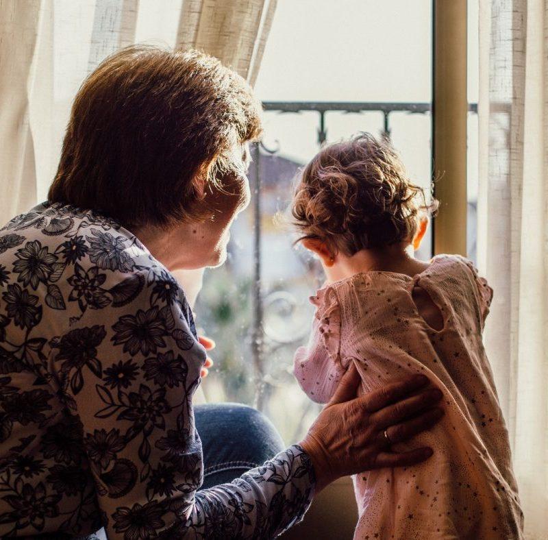 image of older caregiver with toddler