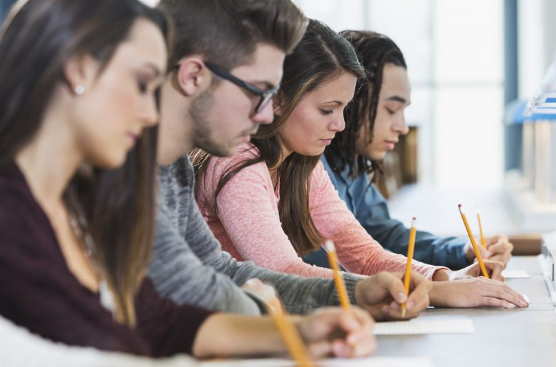 image of students sitting in a row