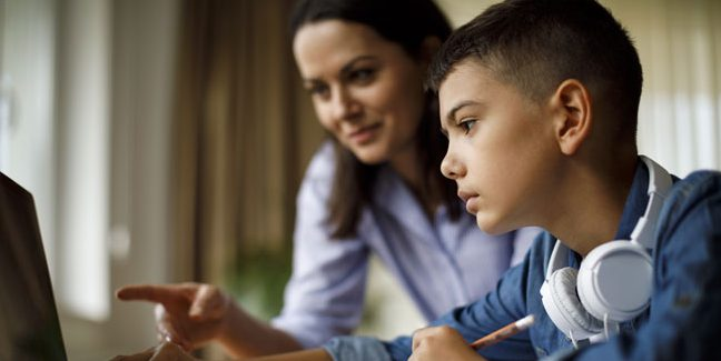 parent working with child on homework.